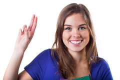 School oath. Smiling girl with raised hand like on school oath Royalty Free Stock Photos