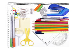 School objects. Variety of school items on notebook Royalty Free Stock Images