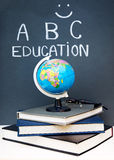 School objects in the classroom. Study time concept, school objects in the classroom, books and globe on the desk Royalty Free Stock Photography
