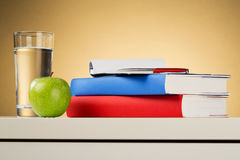 School Objects. On top of a white desk - closeup image with a warm background Stock Image