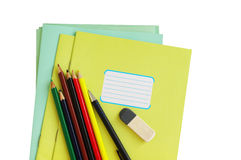 School office the isolated. School office subjects of a notebook and colored pencils on a white background the isolated stock images