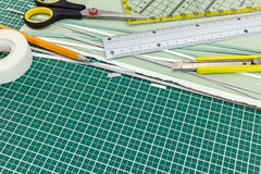 School or office stationery on cutting mat: cutter, pencil, rule Royalty Free Stock Image