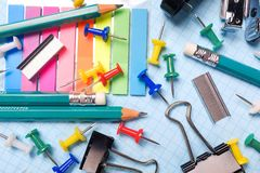 School and office stationery on a white sheet. The concept of education, office work, business, entrepreneurship. Workplace stock photo