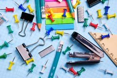School and office stationery on a white sheet. The concept of education, office work, business, entrepreneurship. Workplace stock image