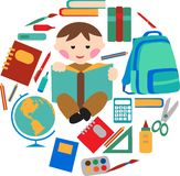 School and office supplies. With boy reading a book Stock Photo
