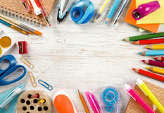 School and office supplies and accessories on aged wooden board Royalty Free Stock Photo