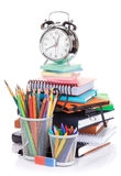 School and office supplies and alarm clock Royalty Free Stock Image