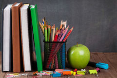School and office supplies and apple Royalty Free Stock Image