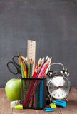 School and office supplies and apple Stock Images