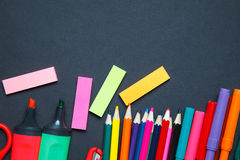 School and office supplies on blackboard background. Stock Photography