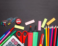 School office supplies on a chalkboard background Royalty Free Stock Photos