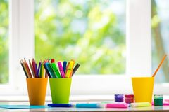 School and office supplies: coloured pencils. Pencils case on white window background royalty free stock photos