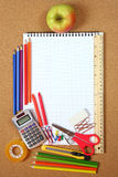 School and office supplies on cork board Stock Images