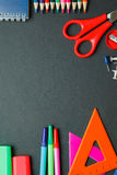 School and office supplies on dark background. Top view with copy space Stock Photos