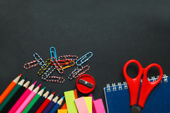 School and office supplies on dark background. Top view with copy space Stock Image