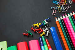 School and office supplies on dark background. Top view with copy space Royalty Free Stock Photos