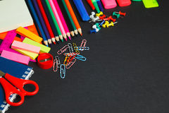 School and office supplies on dark background. Top view with copy space Stock Images