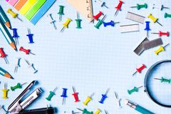 School and office supplies on the freelancer`s desktop. Top view with copy space. Frame with stylish stationery. The concept of stock photos