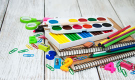 School office supplies. On a old wooden table Stock Photography