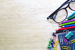 School and office supplies over office table. Stock Photos