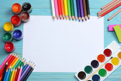 School and office supplies. school background. colored pencils, pen, pains, paper for school and student education. On wooden background. top view with copy stock photography