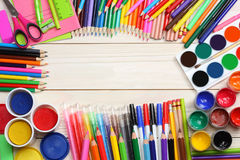 School and office supplies. school background. colored pencils, pen, pains, paper for  school and student education Royalty Free Stock Photo
