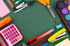 School office supplies stationery on a green background desk with copy space. Back to school concept.  stock photos