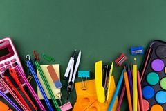 School office supplies stationery on a green background desk with copy space. Back to school concept.  stock photography
