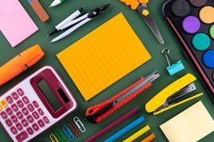 School office supplies stationery on a green background desk with copy space. Back to school concept.  royalty free stock photo