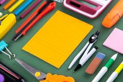 School office supplies stationery on a green background desk with copy space. Back to school concept.  royalty free stock photography