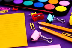 School office supplies stationery on a purple background desk with copy space. Back to school concept.  stock photos