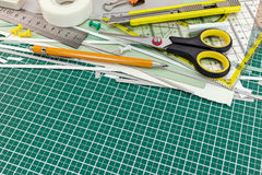 School or office supplies and tools on cutting mat Stock Images