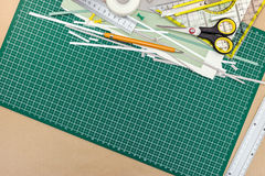 School or office supplies and tools on green cutting mat backgro Stock Photography