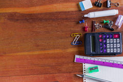 School or Office Supplies on Top of Wooden Table. Captured at Right Border Frame Stock Photos
