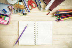 School and office supplies on wood background. Back to school. Stock Photography