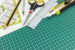 School and office various supplies on green cutting mat Royalty Free Stock Image
