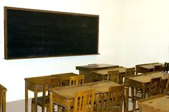 School in old style. Wooden desks, small chairs and simple blacboard. Photo in Hongkong museum Stock Photos