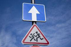 School and One Way Traffic Sign Royalty Free Stock Photography