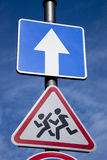 School and One Way Traffic Sign Royalty Free Stock Photos