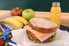 School packed lunch ham and cheese sandwich on classroom table or desk Royalty Free Stock Photo
