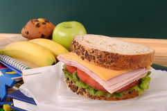 School packed lunch, sandwich, apple, on classroom desk or table Royalty Free Stock Image