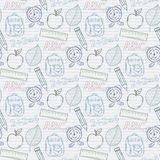 School pattern. Seamless school pattern on the notebook sheet into the linel,with apple,ala rm clock, briefcase, backpack, ruler,leaf Stock Image