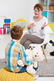 School pedagogue talking with pupil Stock Photography
