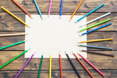 School pencils make a frame on wooden background Royalty Free Stock Images