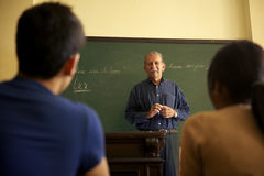 School people, professor talking to students during lesson in co Stock Photography