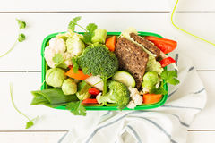 School or picnic lunch box with sandwich and vegetables stock photo