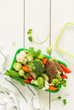 School or picnic lunch box with sandwich and vegetables royalty free stock photos