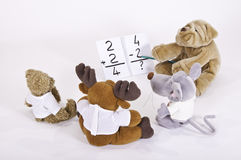 School plushies. This image shows four teddy bears in math class Stock Photos
