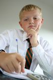 School Pupil. Uniformed school boy in studying pose stock photos