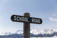 School Road Sign in Mountain Town Royalty Free Stock Photography
